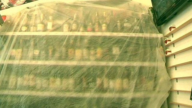 Shelves of alcohol, covered
