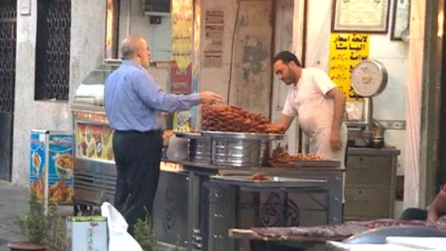 Man buying food at market stall