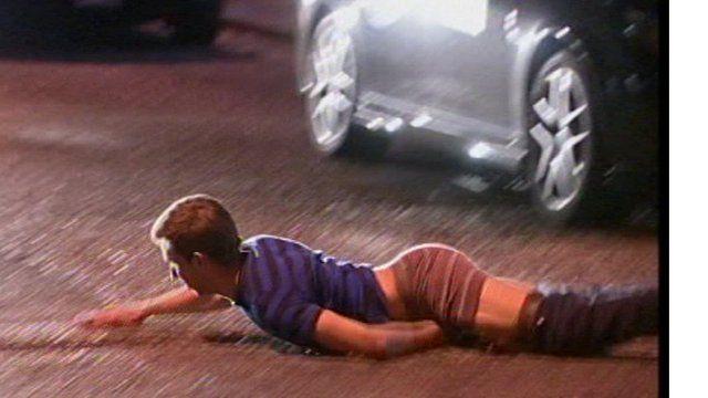 Man lying in a road