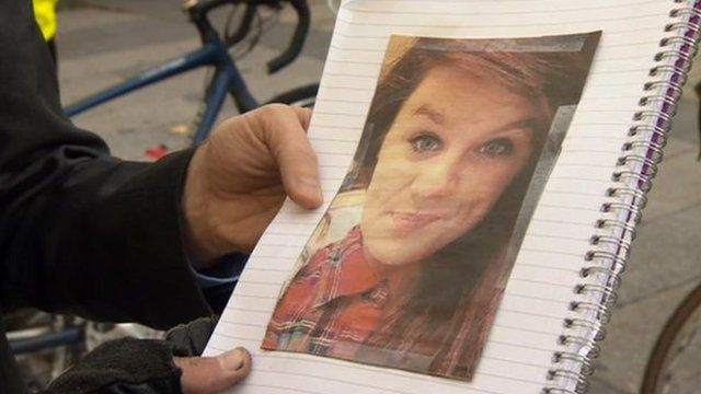 Man holding picture of Megan