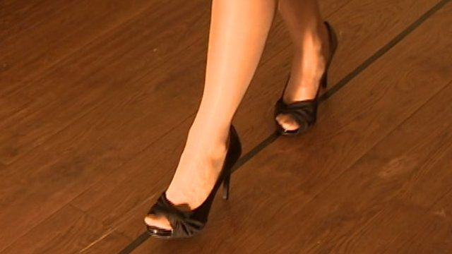 Woman walking in high heels
