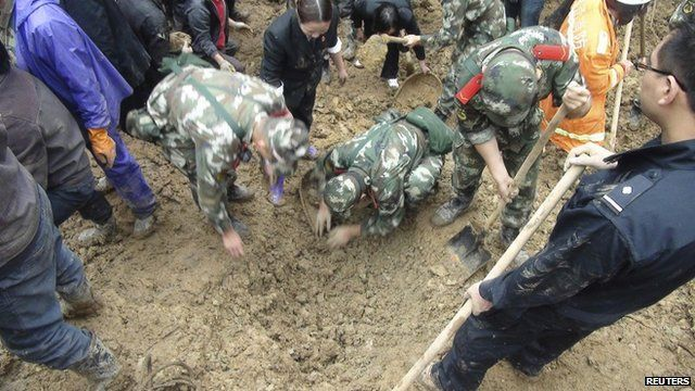 Paramilitary policemen search for victims