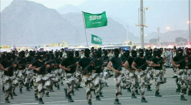 Saudi security forces marching