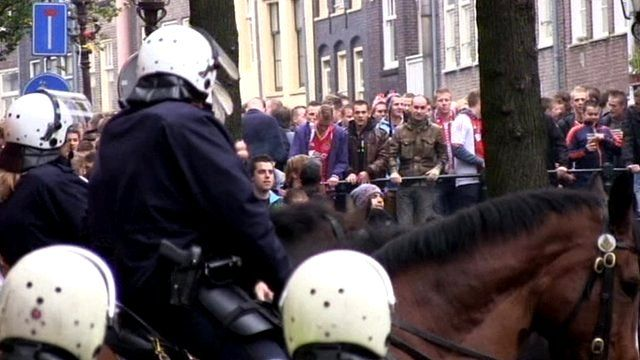 Police and football fans in Amsterdam