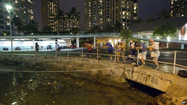 Watching water levels in Ala Wai Harbor, on Oahu island