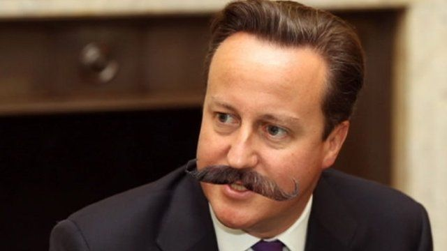 David Cameron with fake moustache