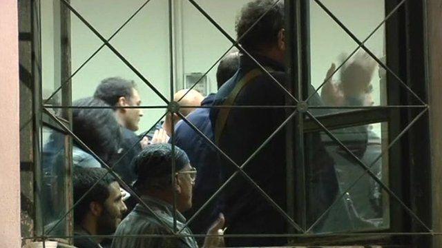 Applause inside Greek court