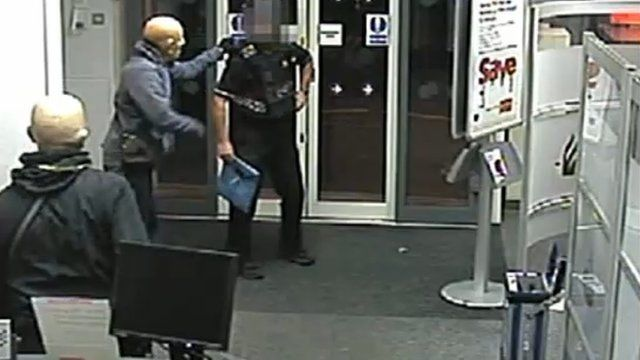 CCTV footage of armed robbers during a raid