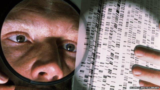 Man looking at DNA sequencing autoradiograms through a magnifying glass