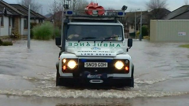 Ambulance driving in flood