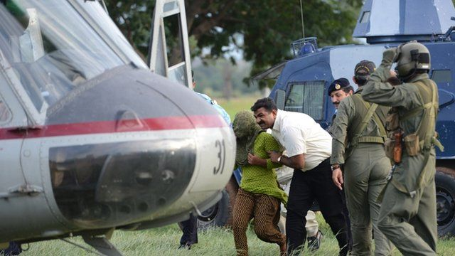 Pakistani security personnel move Rimsha Masih, a Christian girl accused of blasphemy, to a helicopter after her release from jail in Rawalpindi on September 8, 2012