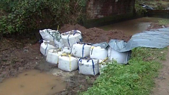 Sandbags beneath a bridge at Halberton in Devon