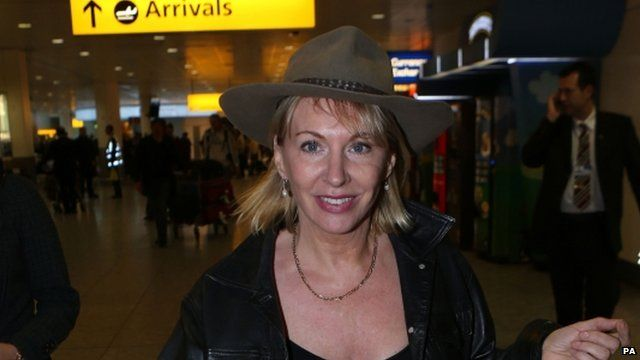 Nadine Dorries arrives back in UK