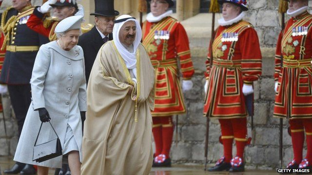 The Amir Sheikh Sabah Al-Ahmad Al-Jaber Al-Sabah of Kuwait chats with Queen Elizabeth II as he arrives at Windsor Castle