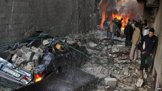 State news agency photograph showing aftermath of the blasts in Jaramana (28 November 2012)