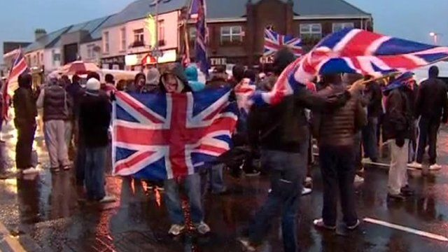 Loyalists hold Union flags in Belfast