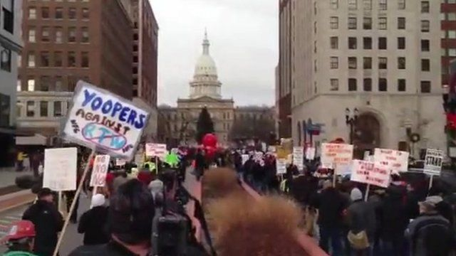 Protesters walk to Michigan state house