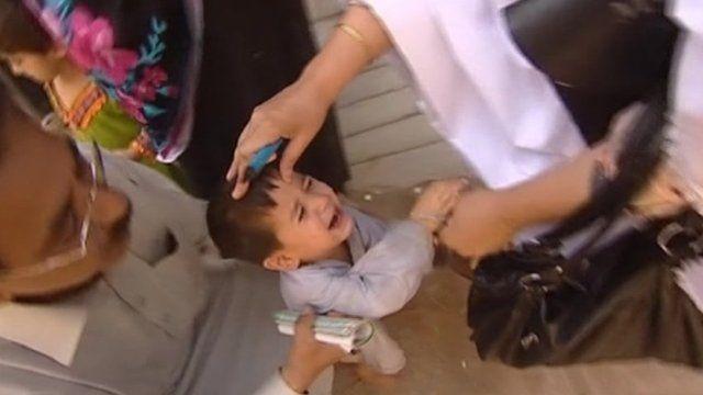 Nurse administering polio medication