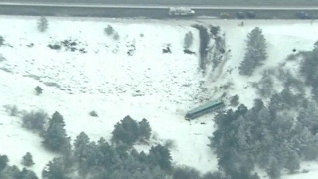 Crashed bus at bottom of embankment in Oregon
