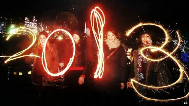 Revellers with sparklers spelling out 2013
