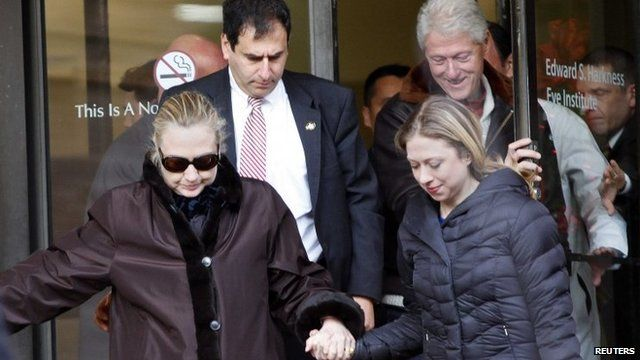 US Secretary of State Hillary Clinton leaves New York-Presbyterian Hospital with husband, Bill (top right), and daughter, Chelsea, in New York, 2 January 2013