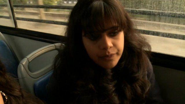 Woman on board a bus in Delhi