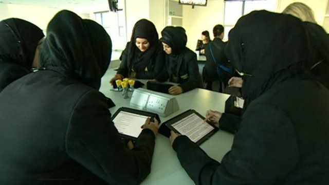 School pupils use iPads