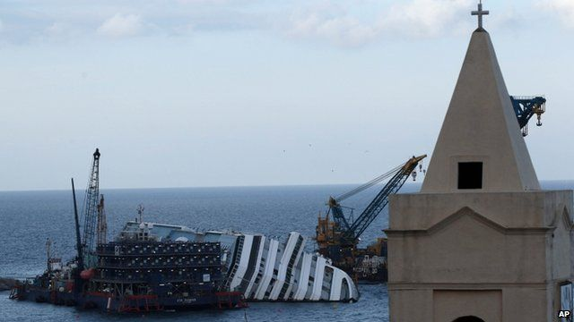 The Costa Concordia cruise ship leans on its side off the Tuscan Island Isola del Giglio, Italy