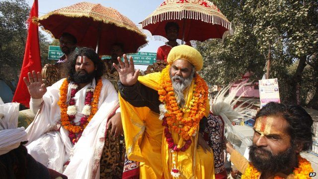 Sadhus, or Hindu holy men, arrive in a religious procession to participate in the Kumbh Mela