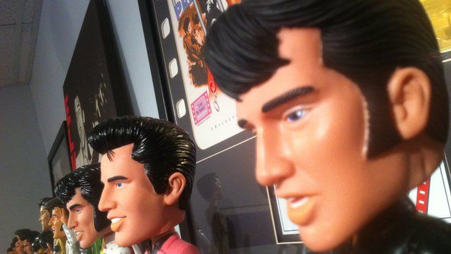 Elvis Presley dolls sitting on a shelf