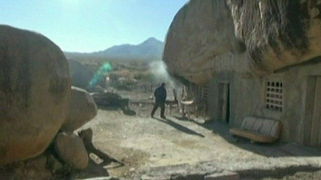 Benito Hernandez outside his cave home