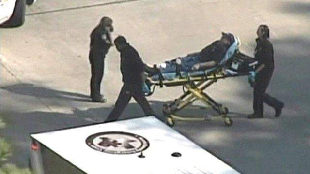 Person being wheeled in stretcher