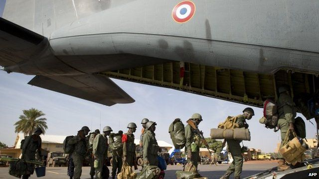 Malian troops boarding a French military transport plane