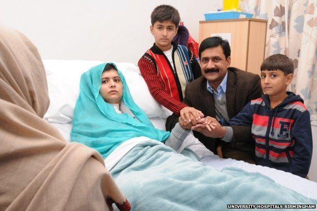 Malala Yousafzai surrounded by family
