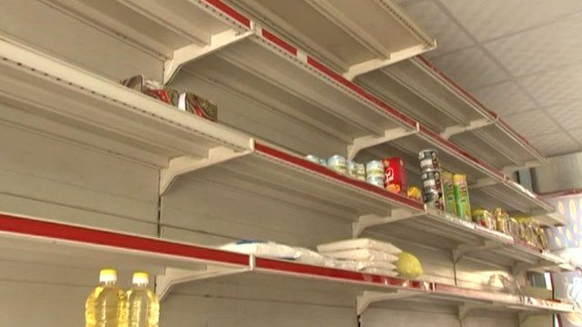 almost empty shelves in grocery store