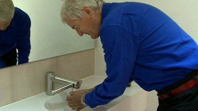James Dyson demonstrates the Airblade tap dryer