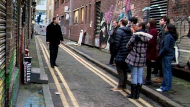 Henri shows his tour group some of London's lesser-known sights