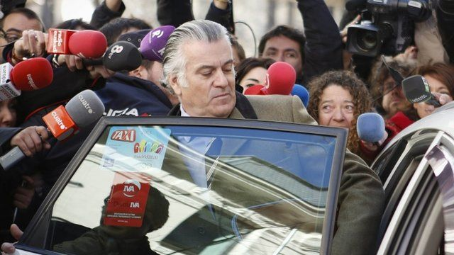 Luis Barcenas is surrounded by journalists