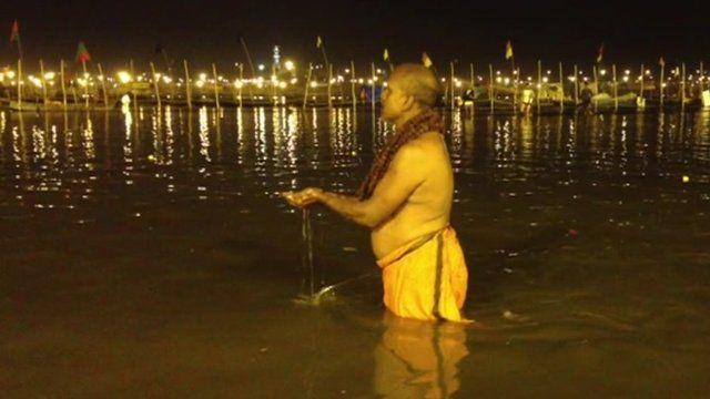 Devotee bathing in river