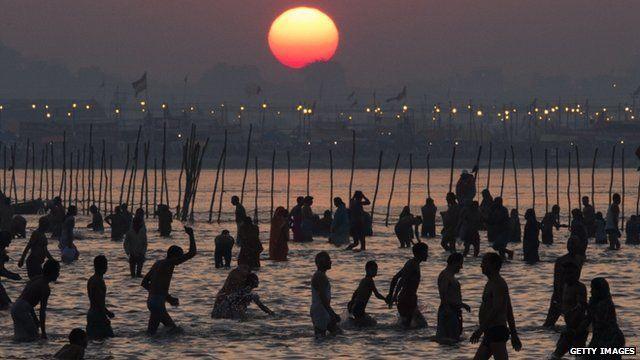 Hindu devotees bathe on the banks of Sangam