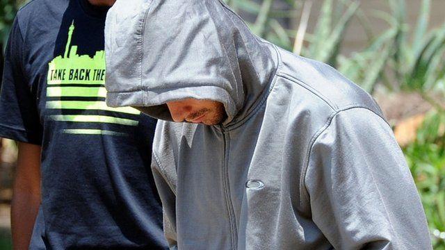 Olympic athlete Oscar Pistorius leaves the Boschkop police station, east of Pretoria