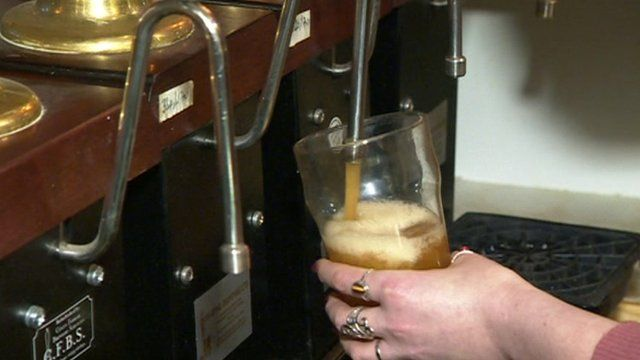 Pint being pulled in pub