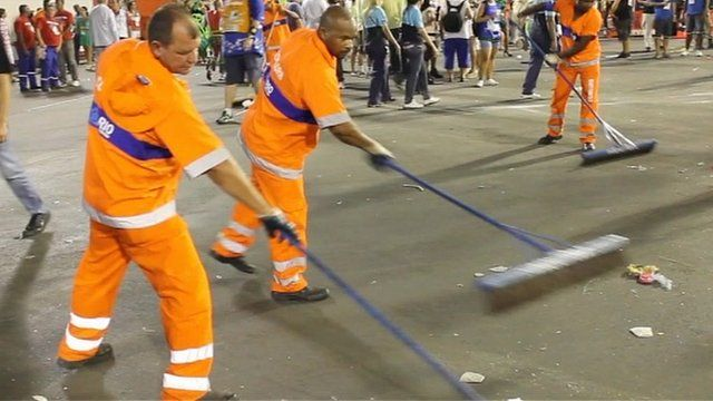 Cleaners sweeping the streets after the Rio carnival