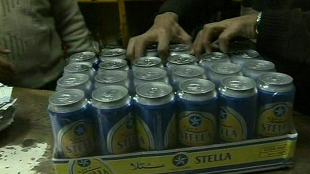 Cans of beer being bought in a Cairo off-licence