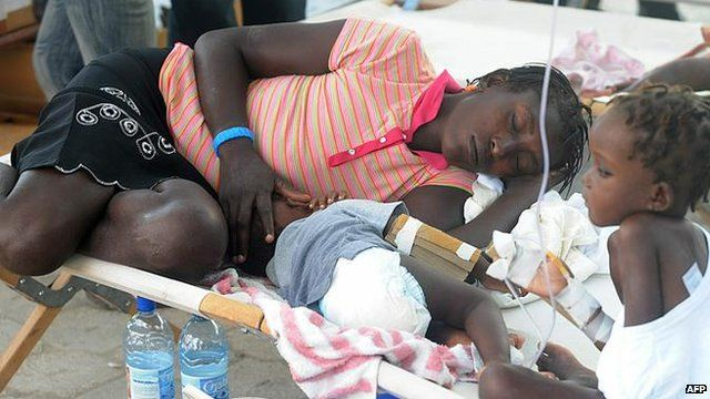 Sick victims and relatives receive treatment in St. Marc, north of Port-au-Prince on October 24, 2010
