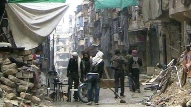 Man sweeping rubble in street