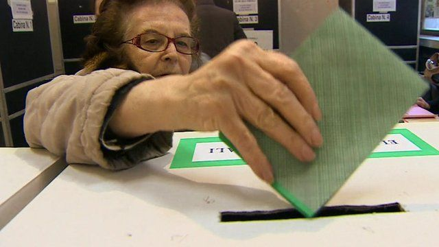 Woman casting her vote