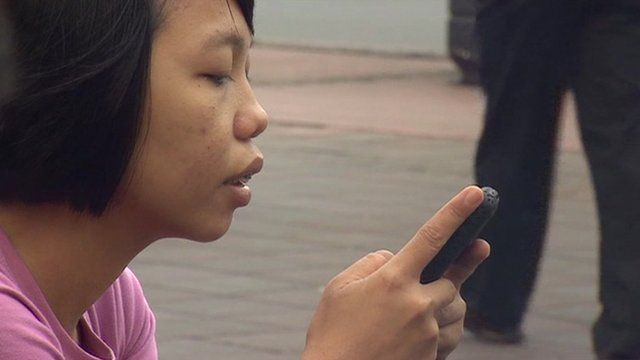 Indonesian woman using a mobile phone