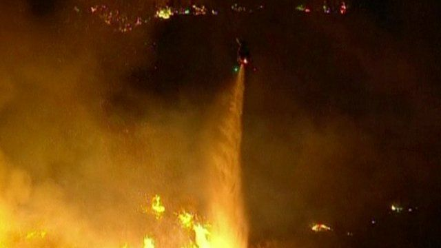 Helicopter pours water to extinguish a wildfire