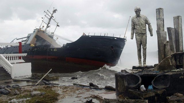 cargo ship stranded on the shore of Colon